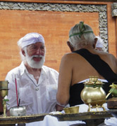Doug von Koss receives a traditional blessing from a Balinese elder during his 2005 tour of Bali.