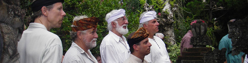 Doug von Koss with a group of men wearing traditional Balinese head wraps wait to recieve a ceremonial blessing during his 2005 guided tour of Bali.
